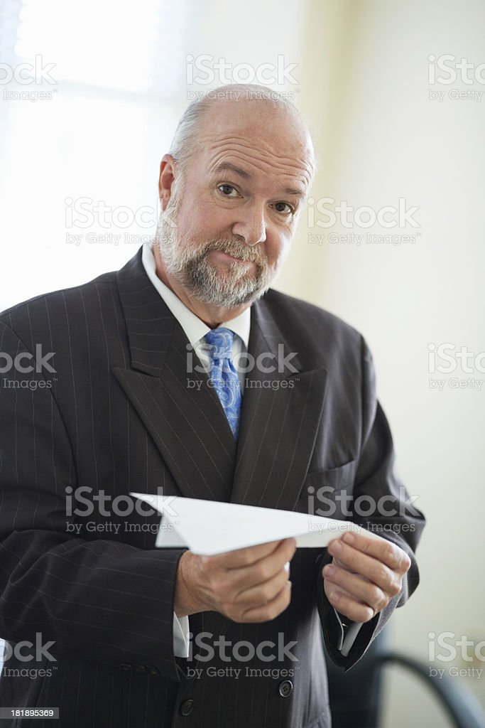 Businessman Holding Paper Airplane royalty-free stock photo