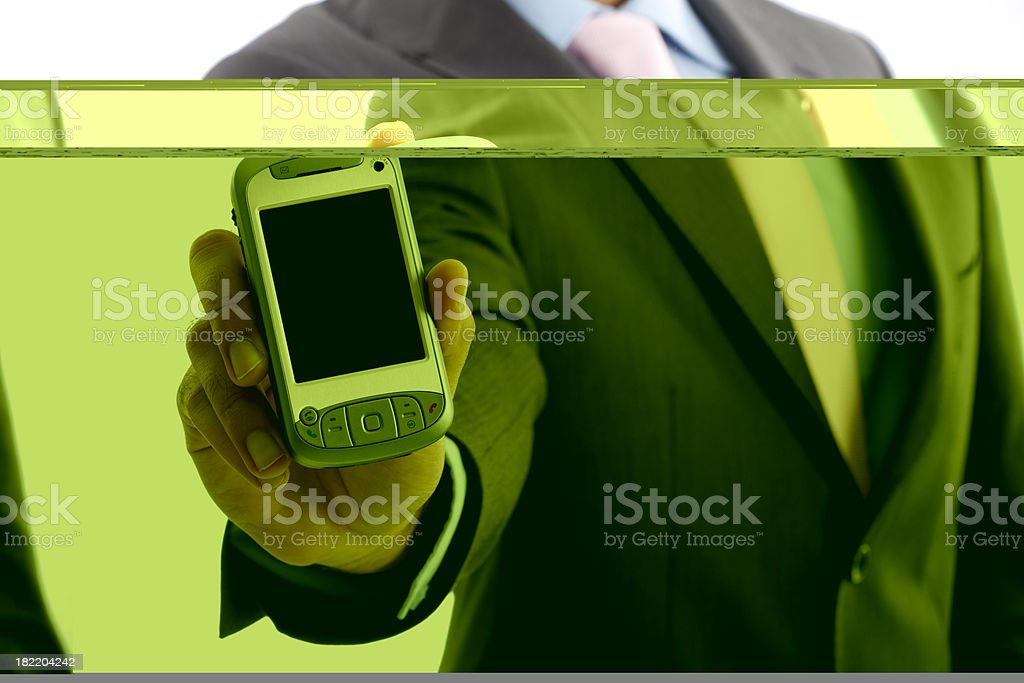 Businessman holding PDA with blank screen royalty-free stock photo