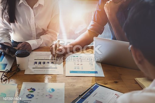 1032388356 istock photo Businessman holding pens and holding graph paper are meeting to plan sales to meet targets set in next year. audit budget and financial concept 1072011524