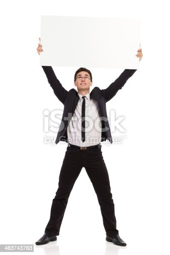 istock Businessman holding placard above his head. 463743763