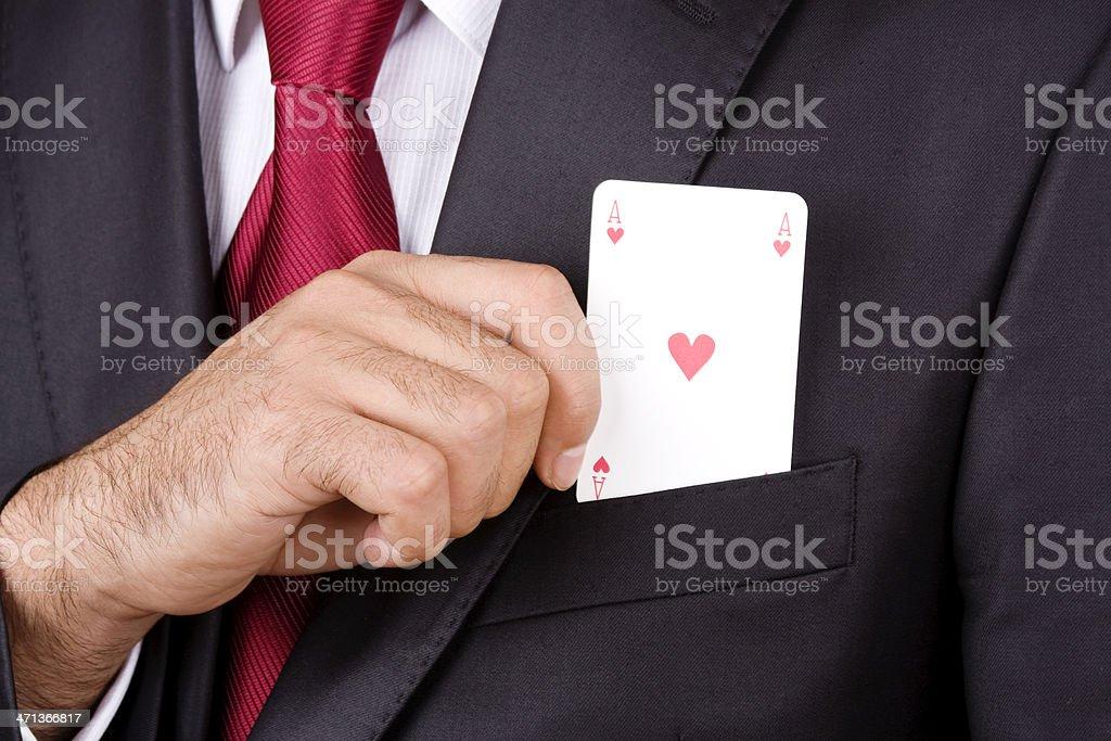 Businessman holding play card stock photo