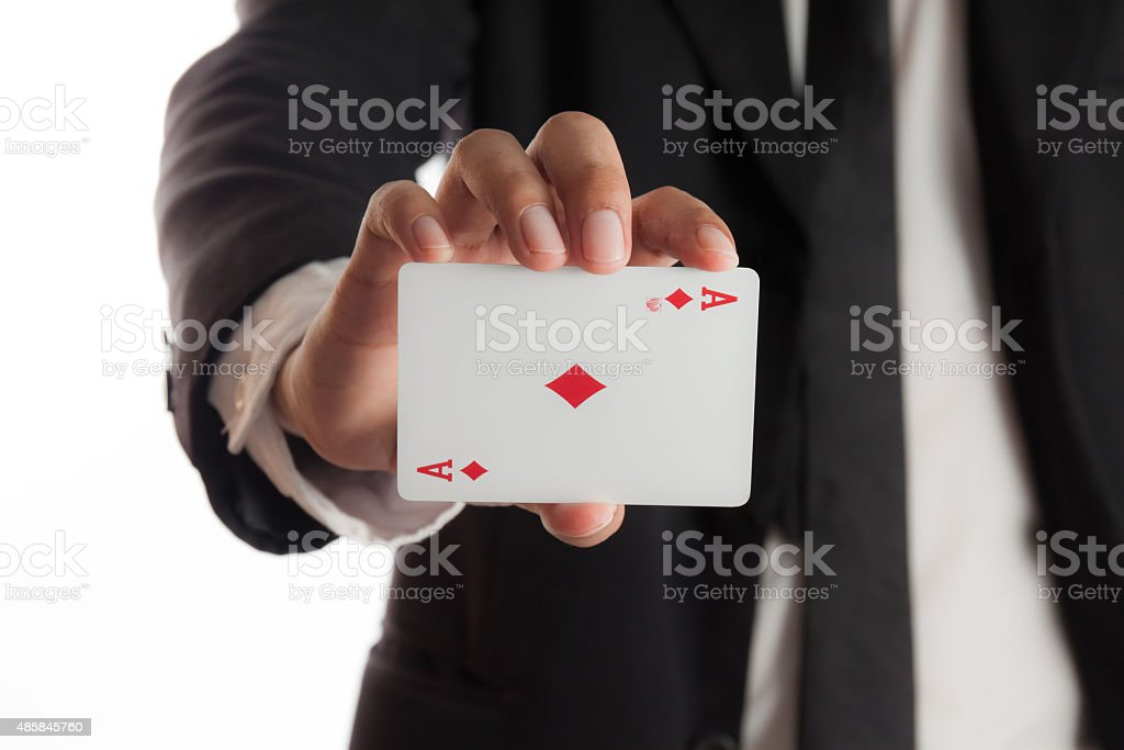 businessman holding playing cards stock photo