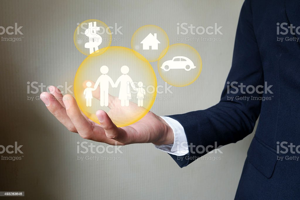Businessman holding protect family , insurance concept stock photo