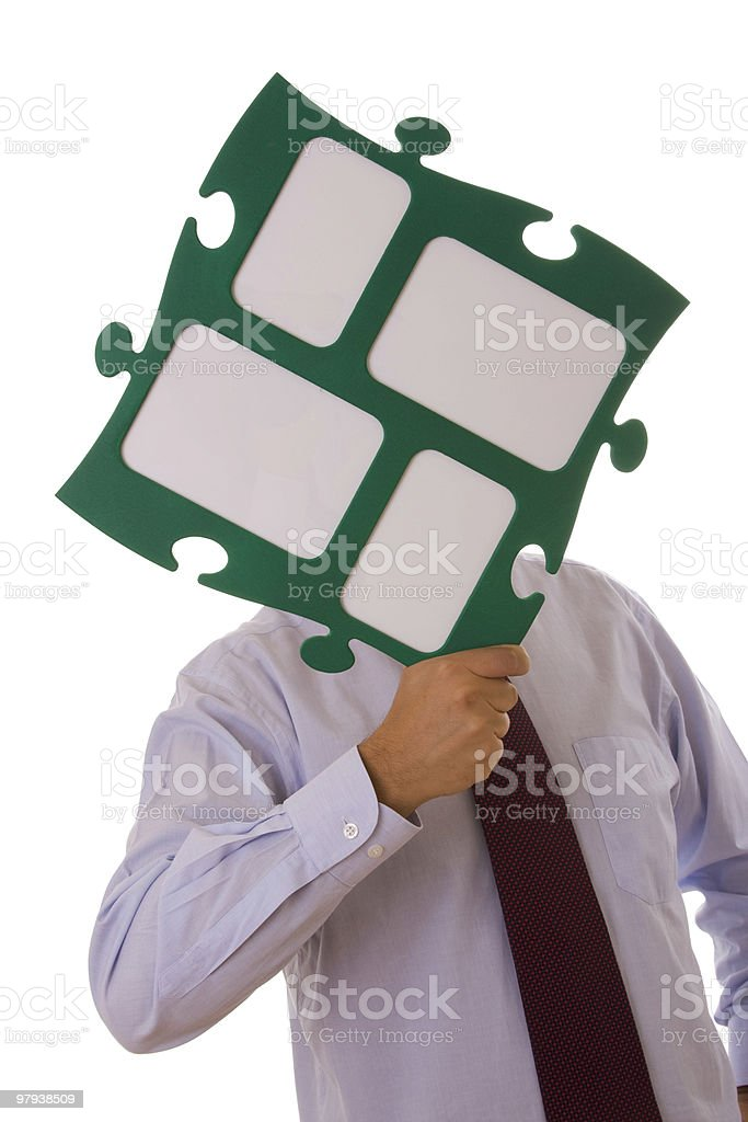 businessman holding puzzle piece royalty-free stock photo