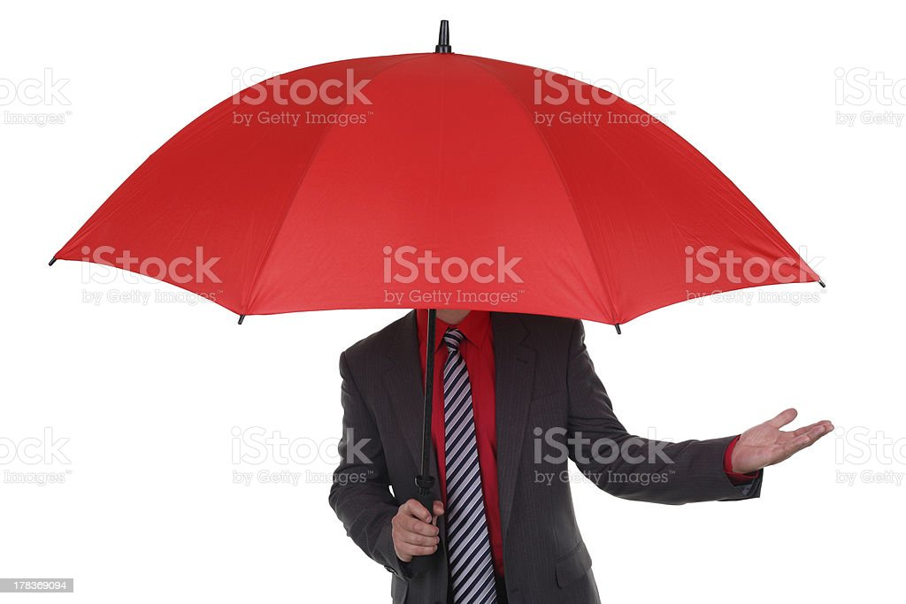 Businessman holding red umbrella royalty-free stock photo