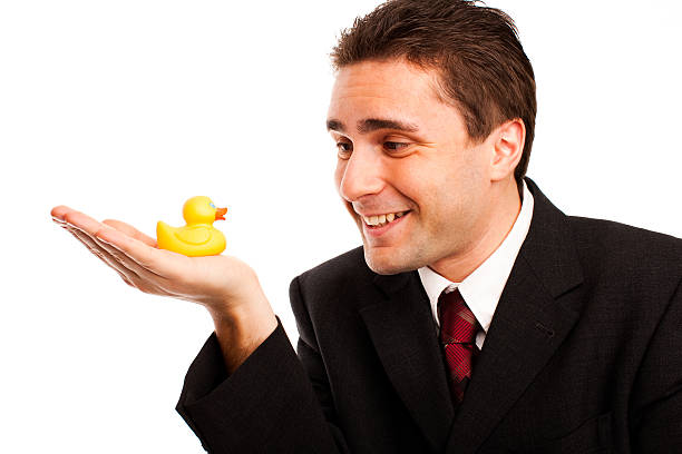 businessman-holding-rubber-ducky-studio-