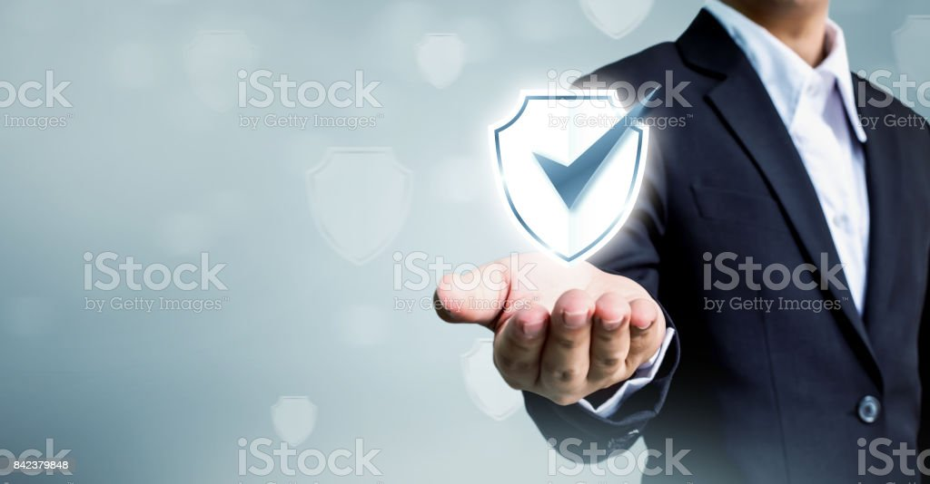 Businessman holding shield protect icon, Concept cyber security safe your data stock photo
