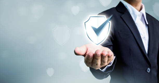 businessman holding shield protect icon, concept cyber security safe your data - protezione foto e immagini stock