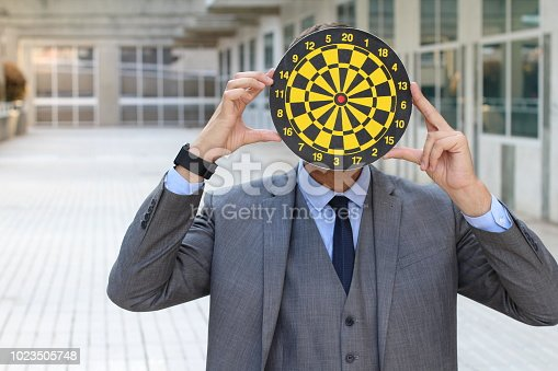 istock Businessman holding shooting ring in the office 1023505748