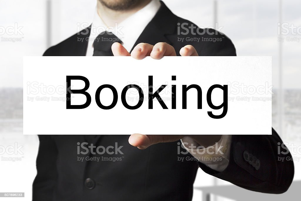 businessman holding sign booking royalty-free stock photo