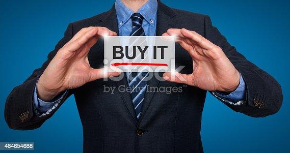 641289780 istock photo Businessman Holding Sign Buy it 464654688