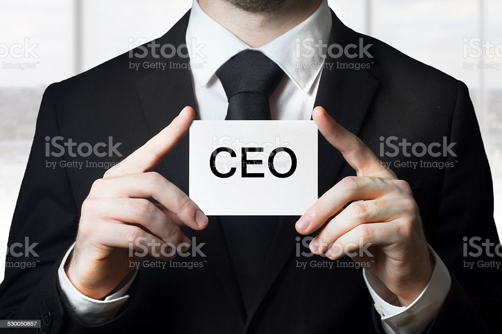 businessman holding sign ceo stock photo