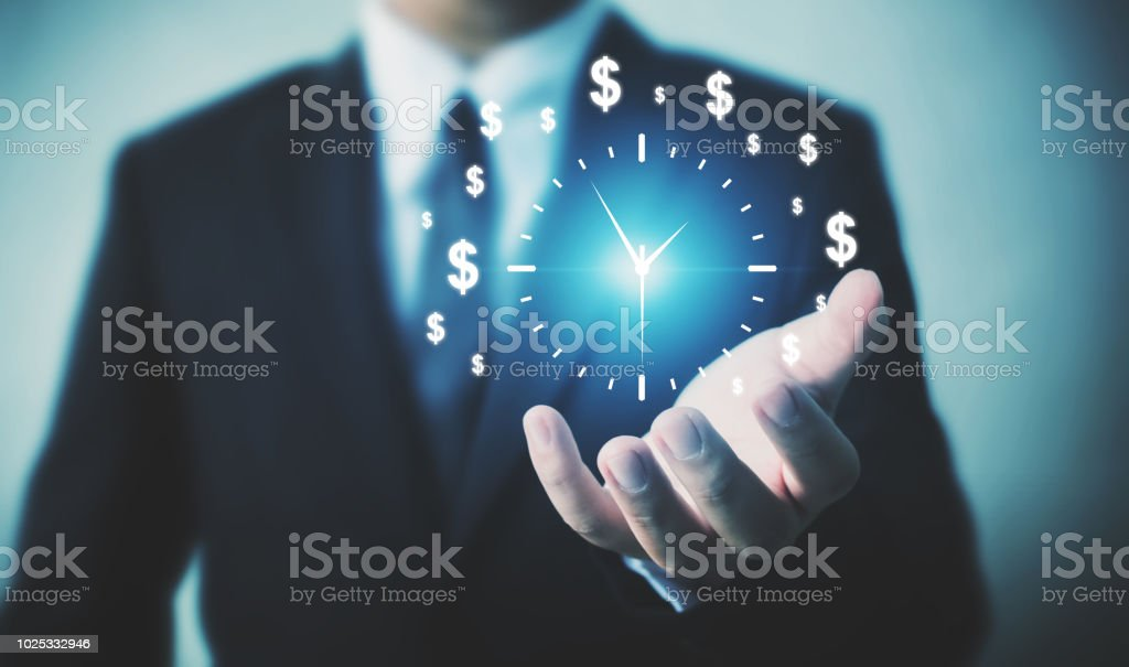 Businessman holding sign clock. Concept business time is money stock photo