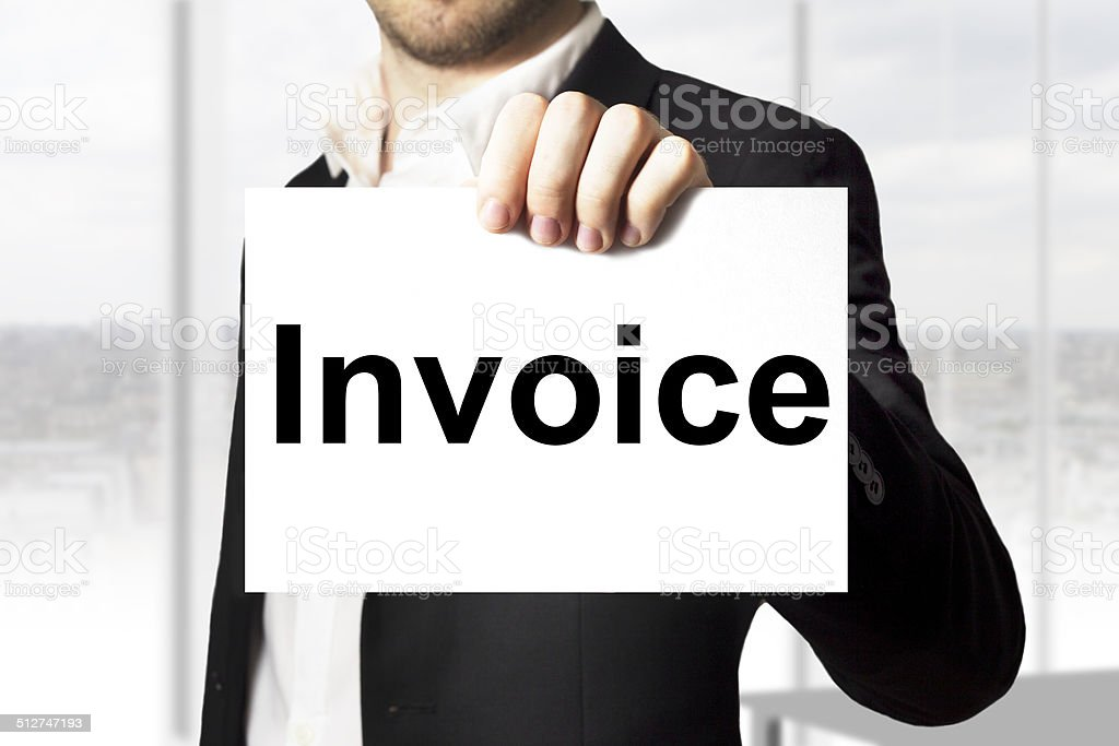 businessman holding sign invoice payment stock photo