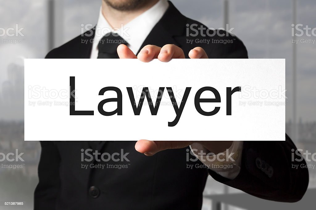 businessman holding sign lawyer stock photo