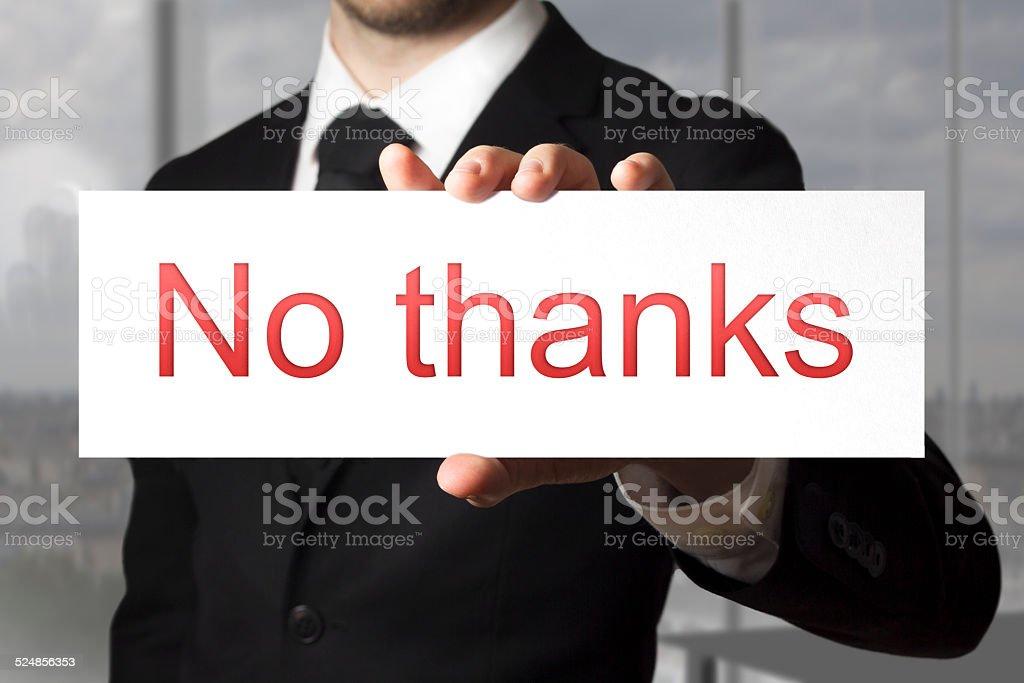 businessman holding sign no thanks refusal stock photo