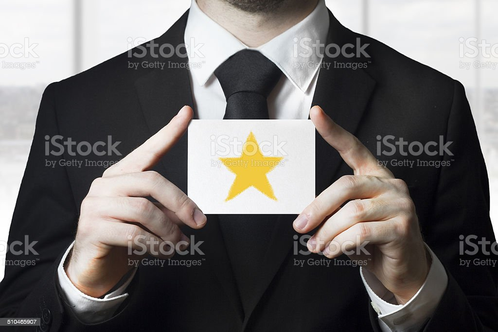 businessman holding sign rating star gold stock photo