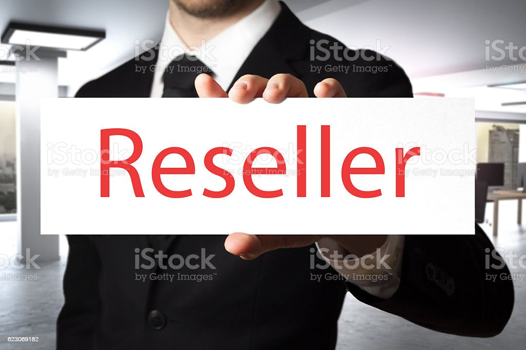 businessman holding sign reseller stock photo
