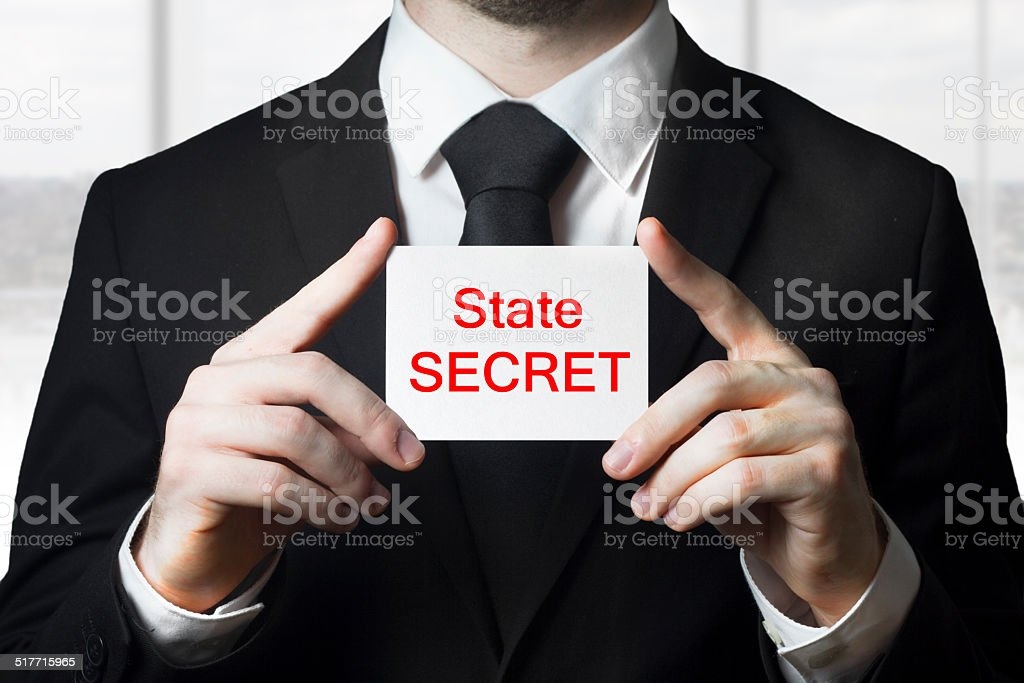 businessman holding sign state secret stock photo