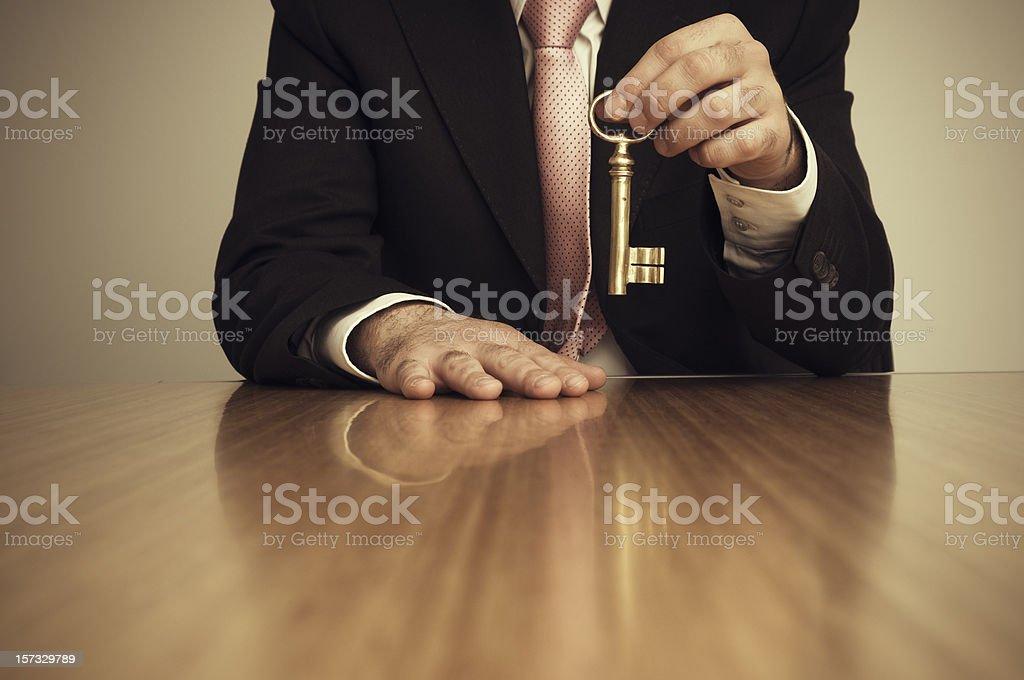 Businessman Holding Skeleton Key royalty-free stock photo