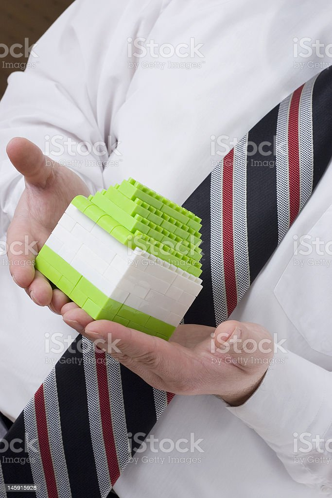 businessman holding small house royalty-free stock photo