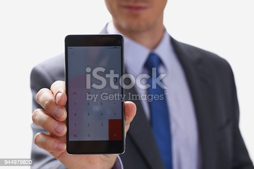 995213208 istock photo businessman holding smartphone in hand 944979820