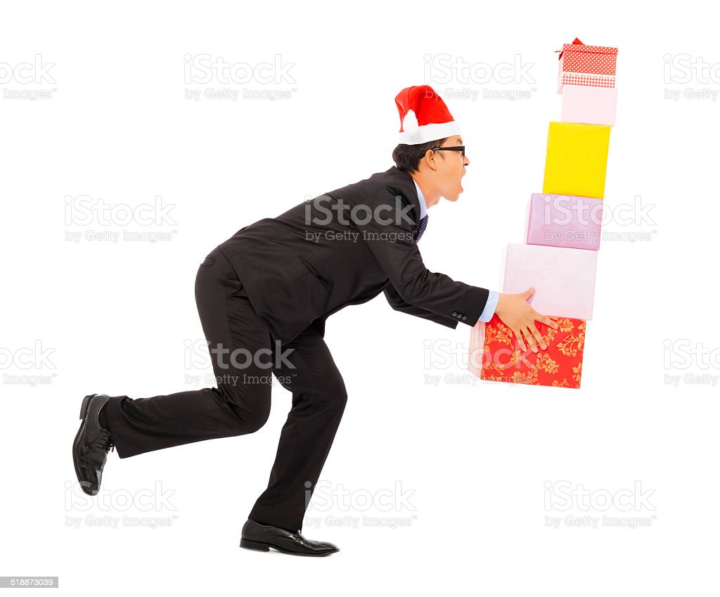 businessman holding some gift boxes. isolated on white stock photo