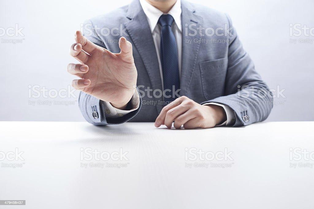 Businessman Holding Something stock photo