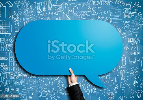 465462550istockphoto Businessman holding speech bobble / Blue board concept (Click for more) 915109566