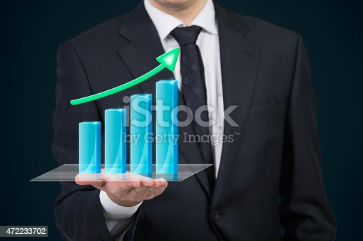 businessman holding stock chart with arrow