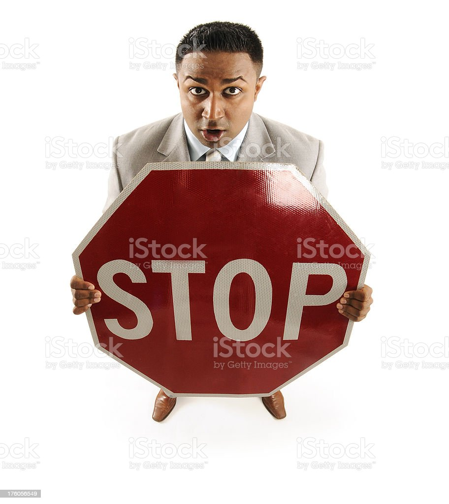 Businessman Holding Stop Sign royalty-free stock photo