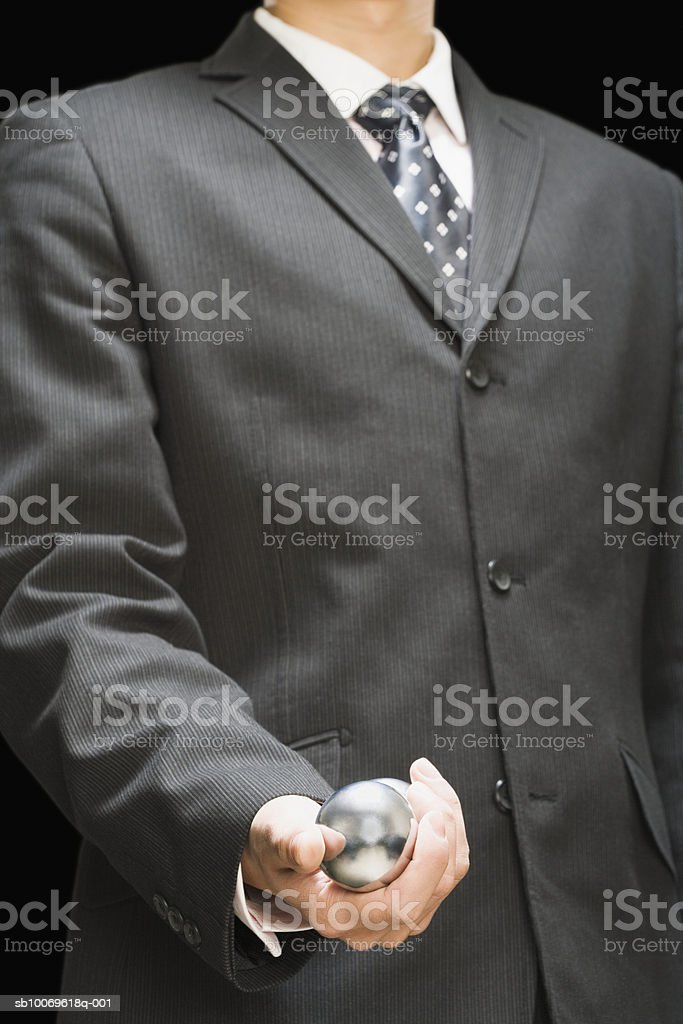 Businessman holding stress ball, mid section royalty-free 스톡 사진