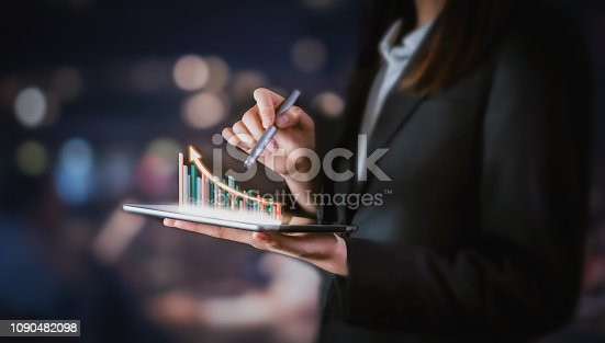 Businessman holding tablet and have a chart showing business growth. positive indication of income.