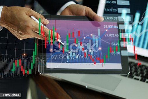865596974istockphoto Businessman holding tablet and present financial stock market graph and economic growth chart, Business strategy and planning concept. 1185375006