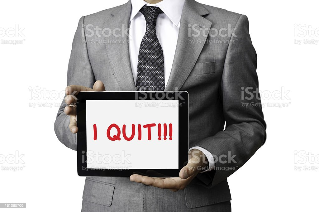Businessman holding tablet computer that reads 'I quit!! royalty-free stock photo