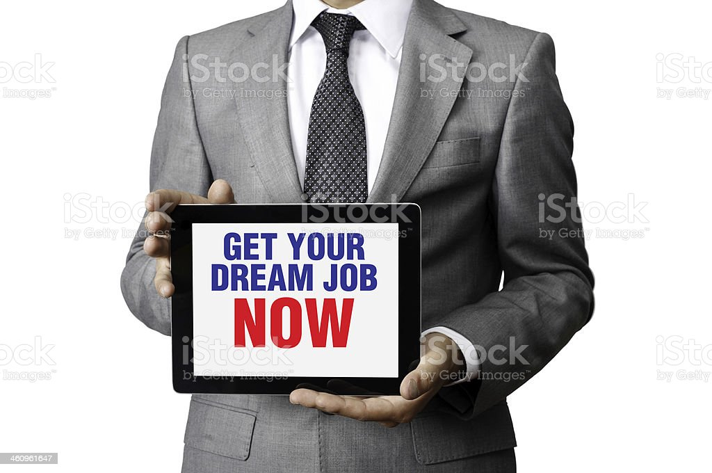 Businessman holding tablet pc with 'Get Your Dream Job Now' stock photo