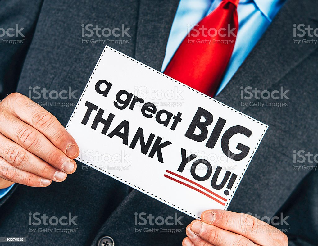 Businessman holding thank you sign stock photo