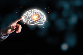 istock Businessman holding the blue virtual brain. Creative new business idea concept. 1226587877