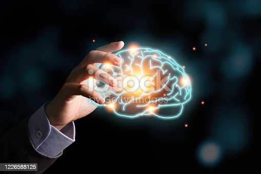 881350654 istock photo Businessman holding the blue virtual brain. Creative new business idea concept. 1226588125