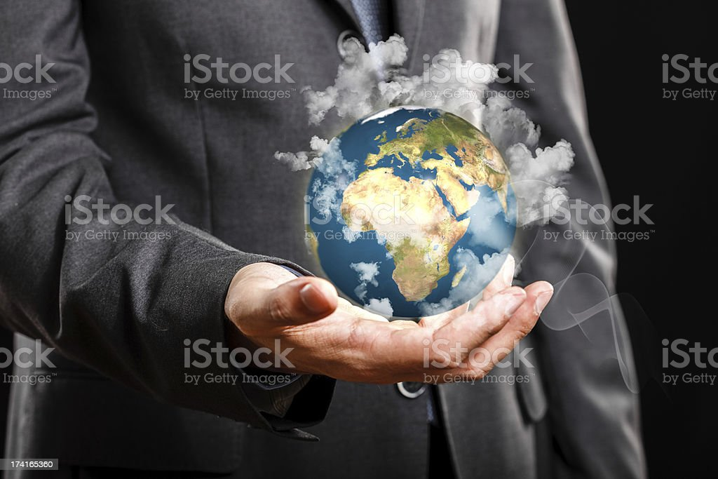 Businessman holding the world in his hand royalty-free stock photo