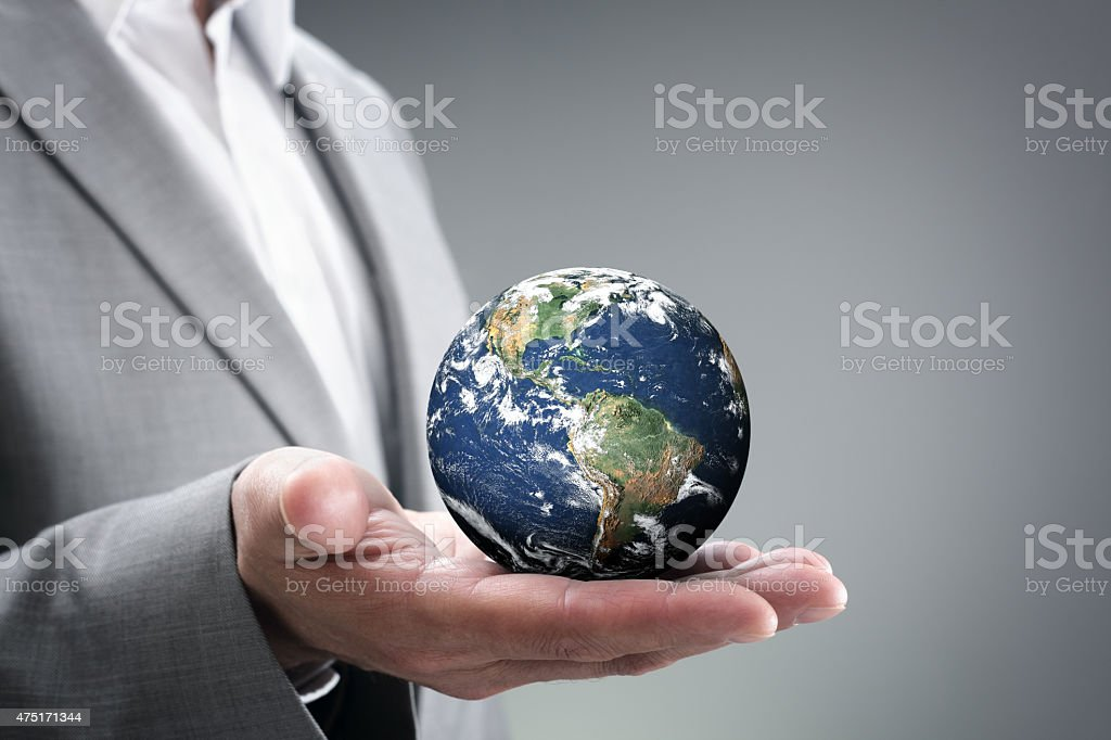 Businessman holding the world in his hands stock photo