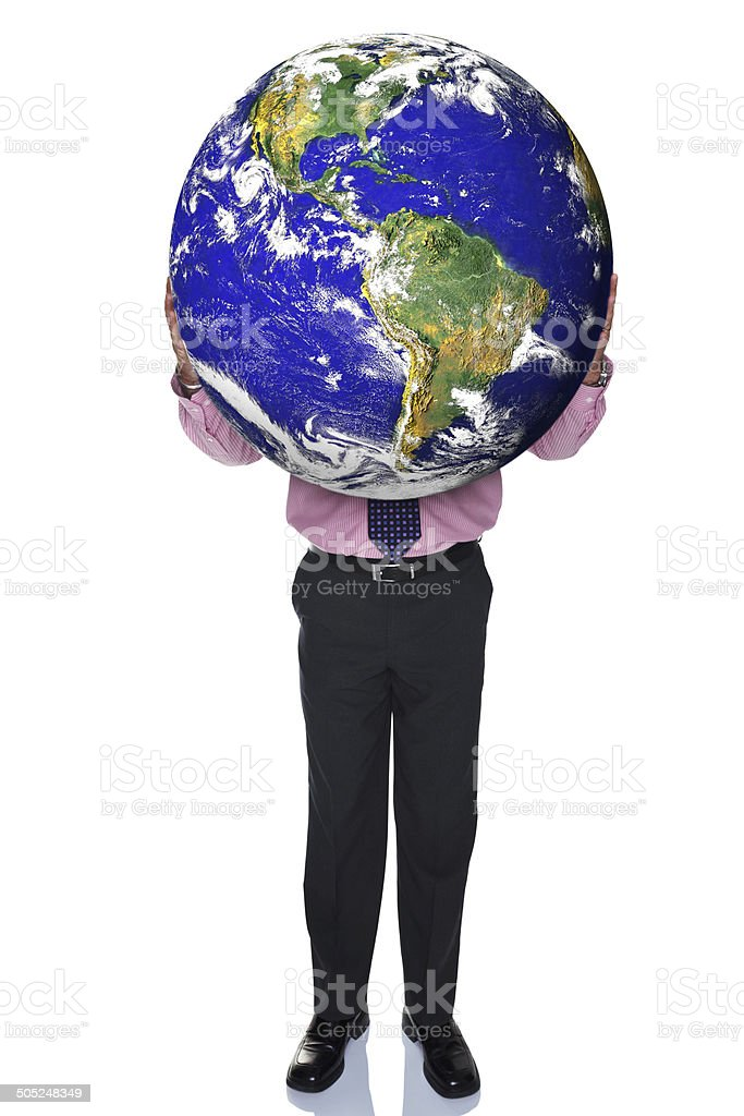 Businessman holding the world royalty-free stock photo