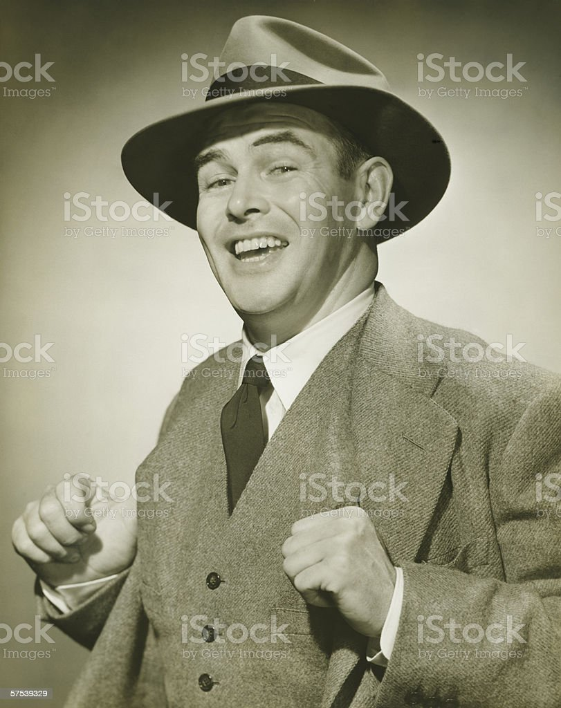 Businessman holding thumbs in waistcoat, smiling, (B&W), portrait royalty-free stock photo