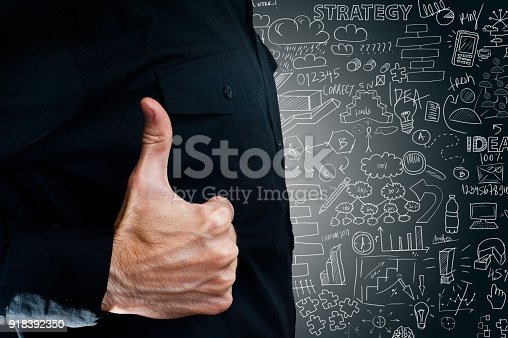 istock Businessman holding thumbs up with charts and diagrams on background (Click for more) 918392350