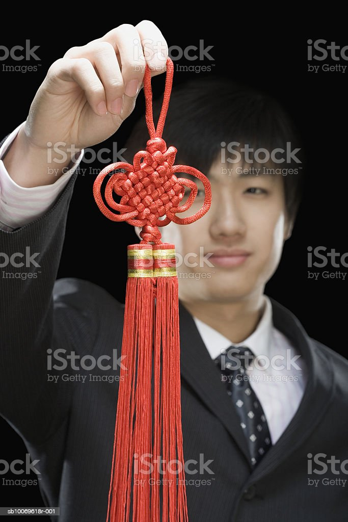 Businessman holding traditional Chinese wall hanging foto royalty-free
