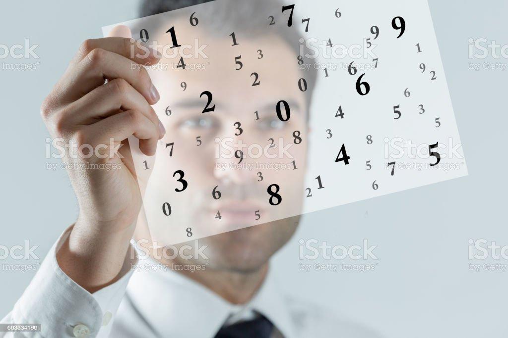 Businessman holding transparency sheet stock photo