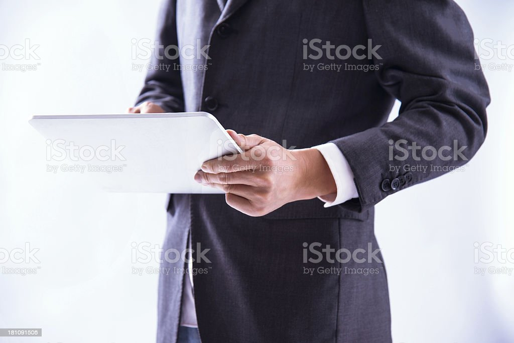 businessman holding with digital tablet royalty-free stock photo