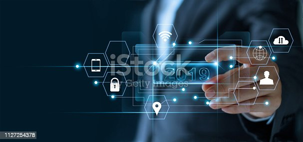 1051659174istockphoto Businessman holding word number 2019 in hand with icon network connection on virtual screen, business strategy, banking and investment, digital marketing and payment, 2019 New year planning business and financial concept. 1127254378