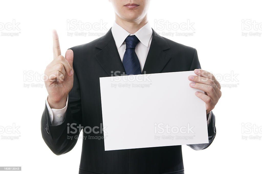 Businessman holds a blank sheet of cardboard royalty-free stock photo