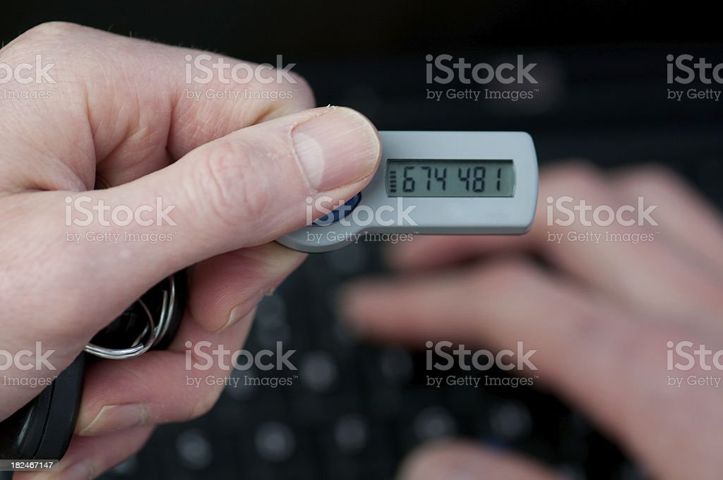 Businessman holds a secure identification device in hand royalty-free stock photo